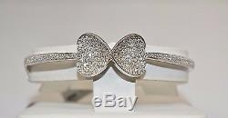 4075-14k White Gold Diamond Bow Design Bangle 1.12tcw 15.13grams