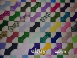 Cream & Multi-colored Full Size Bow Tie Quilt measures 80x97 inches