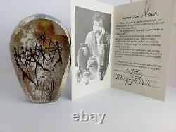 Richard Satava 1996 Petroglyph Cave, warriors with bows, signed glass paperweight